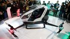 The EHang 184 autonomous aerial vehicle is unveiled at the EHang booth at CES International in Las Vegas, Nevada. The drone is large enough to fit a passenger. Photograph: John Locher/AP