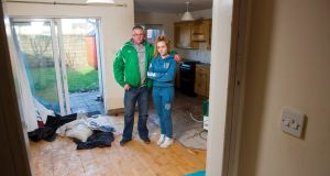 Ryszard Suchowiecki and his daughter Paulina at their home in Midleton, which was damaged in recent flooding. Photograph: Daragh Mc Sweeney/Provision