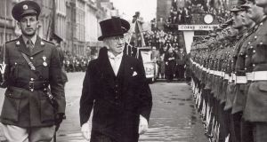 Former president Seán T O'Kelly inspecting a guard of honour outside the GPO in 1957.