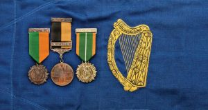 The medals of former president of Ireland Seán T O'Kelly against the pennant carried on the president's car. Photograph: Spink