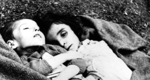 Shoah: two children found barely alive at Bergen-Belsen concentration camp after it was liberated, towards the end of the second World War, in 1945. Photograph: Galerie Bilderwelt/Getty