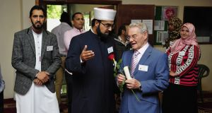 Reconciliation: Tomi Reichental with Shaykh Umar al-Qadri, of Blanchardstown mosque, where Reichental spoke on his 80th birthday, last June. Photograph: Aidan Crawley