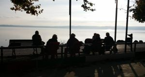 Old country: Trevignanesi assemble to put the world to rights, at sunset by Lake Bracciano. Photograph: Paddy Agnew