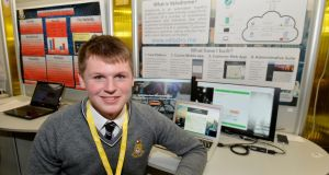 "Best individual winner Shane Curran from Terenure College with his project ""Velodrome – The Automated Logistics Fulfilment Platform"" at the 52nd BT Young Scientist & Technology Exhibition. Photograph: Alan Betson/The Irish Times"