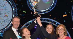Young Scientists of the Year Maria Louise Fufezan and Diana Bura from Loreto Secondary School Balbriggan with managing director of BT Ireland Shay Walsh and Minister for Education Jan O'Sullivan at the RDS. Photograph: Alan Betson/The Irish Times
