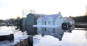 Floods surround a house in the Golden Island area of Athlone.  Photograph: Bryan O'Brien / The Irish Times