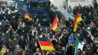 German police drive back protesters at a demonstration by Pegida in Cologne, Germany. Photograph: Roland Weihrauch/EPA