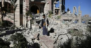 A Yemeni stands amid the rubble of a building destroyed by air strikes in Sana'a, Yemen. MSF has said that three people have been killed in a rocket attack on one of their health centres in Yemen. File photograph: Yahya Arhab/EPA