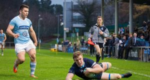 Daniel Leavy scores UCD's  sixth try against Garryowen at the Belfield Bowl where the students triumphed 45-19. Photograph: Ryan Byrne/Inpho