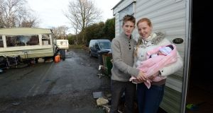 Tom and Elizabeth Moorehouse with their four-week-old baby Kathleen at the Traveller site where they live near Bray, Co Wicklow. Photograph: Eric Luke.