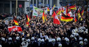 Supporters of Pegida and other right-wing  groups gather  to protest against the New Year's Eve sex attacks  in Cologne on Saturday. Photograph: Sascha Schuermann/Getty Images