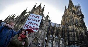 Protesters gather in front of Cologne cathedral to protest against the New Year's Eve sex attacks. Photograph: Sascha Schuermann/Getty Images