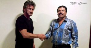 "Actor Sean Penn shakes hands with Mexican drug lord Joaquin ""el Chapo"" Guzman in Mexico, in this undated Rolling Stone photograph. Photograph: Reuters/Rolling Stone"