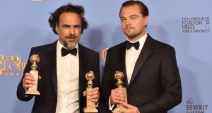 "Alejandro Gonzalez Inarritu (left), winner of Best Motion Picture - Drama and Best Director - Motion Picture for ""The Revenant,"" and actor Leonardo DiCaprio, winner of Best Performance by an Actor in a Motion Picture - Drama for ""The Revenant,"" at the 73rd Annual Golden Globe Awards Photograph: Kevin Winter/Getty Images"
