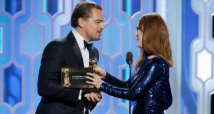 "Julianne Moore (right) presents Leonardo DiCaprio with the award for Best Actor - Motion Picture, Drama for ""The Revenant""at the 73rd Annual Golden Globe Awards at The Beverly Hilton Hotel on January 10th, 2016 in Beverly Hills, California. Photograph: Paul Drinkwater/NBCUniversal via Getty Images"