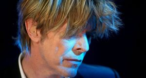 In an overmediated time where social media robs everything of its mystery, Bowie's obstinate refusal to play along is almost a work of art in itself. Photograph: Fabrice Coffrini/EPA