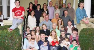 Tom Ahern and his wife Kathleen with their six children and 18 of their 20 grandchildren.