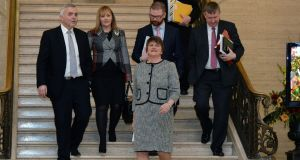 Democratic Unionist Party leader Arlene Foster (3rd L) makes her way through the Great Hall at Stormont with party colleagues  in Belfast, Northern Ireland. Photograph: Charles McQuillan/Getty Image)
