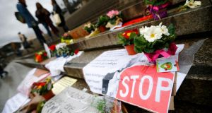 "Flowers and posters are placed in the square between the city cathedral and the railway station in Cologne, Germany, January 11th, 2016, where the vast majority of dozens of New Year Eve assaults on women took place. Some of the messages  read ""Sexual harassment against women will be NOT tolerated"". Photograph: Wolfgang Rattay/Reuters"