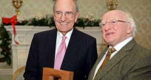 President Michael D Higgins  presents former US senator George Mitchell (left) with a Presidential Distinguished Service Award for the Irish Abroad  at Áras an Uachtaráin, Dublin,  in late 2013. File photograph: Eric Luke/The Irish Times