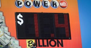 "A worker changes the word ""million"" to ""billion"", indicating the new jackpot amount for the multi-state Powerball lottery jackpot, now the largest in world history, in downtown Atlanta, Georgia, USA, 11th January 2016.  John Amis/EPA"