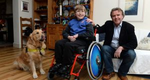 Tom Clonan, his son Eoghan (13) and Eoghan's care dog Duke. Photograph: Cyril Byrne