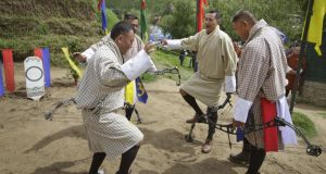 Bhutan's national sport: archers celebrate after a team-mate hits a target during a tournament. Photograph: Kuni Takahashi/New York Times