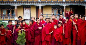 Royal line-up: young Buddhist monks line up to greet the king and queen of Bhutan during a visit to their monastery. Photograph: Kristen Elsby/Moment/Getty