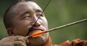 Bhutan's national sport: a competitor in an archery tournament. Photograph: Kuni Takahashi/New York Times