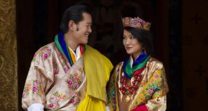 Royal couple: King Jigme Khesar Namgyel Wangchuck and Queen Jetsun Pema after their marriage, in 2011. Photograph: Paula Bronstein/Getty