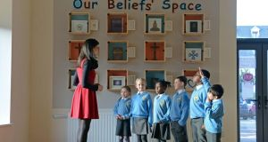 Amy Looney with second-class pupils, from left: Amelia Ziembra (7), Kamile Kisieliute (7), Haliyat Giwa (7), Dylan Keogh (7), Julien Bell Baho (8), and Adam Al Jabar (8) at Citywest and Saggart Community National School. Photograph: Eric Luke