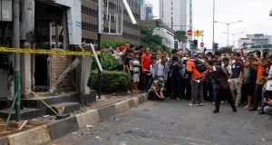 People photograph the scene of a bomb blast at a police post on a traffic island on J1 Thamrin, in Jakarta, Indonesia,  January 14th,  2016. Photograph: Roni Bintang/EPA