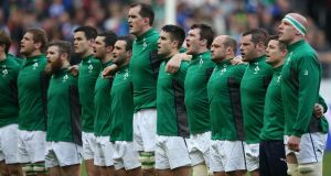 The Irish rugby team stand for the national anthem. Fianna Fáil Senator Mark Daly has said the national anthem should be brought back in to copyright. File photograph: ©INPHO/Billy Stickland