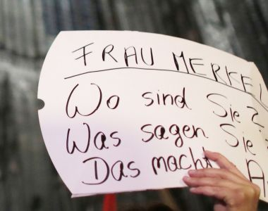 "A sign at a demonstration in Cologne on January 5th reading: ""Angela Merkel – Where are you? What do you say? It is frightening."" Photograph: Oliver Berg /AFP/Getty Images"