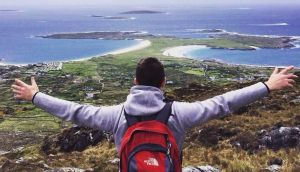 Staying put: Conor Hynes – looking over the Gurteen Bay and Dog's Bay beaches, in Connemara – decided to try to ride out the recession here