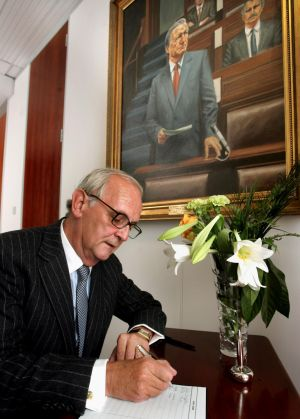 PJ Mara signs a book of condolence for former taoiseach Charles Haughey  at Fianna Fail party headquarters in Mount Street, Dublin. Photograph: The Irish Times