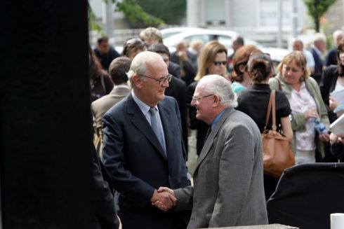 PJ Mara greets photographer Colman Doyle at the funeral of Charles Haughey. Photograph: The Irish Times Archive
