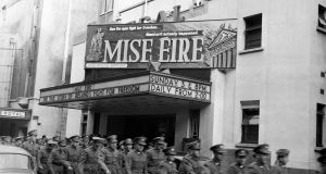 Soldiers attend Mise Eire. George Morrison's film showed over twenty years of Irish history, from the 1890s to 1918, through existing archive material. Its soundtrack, an orchestral score by Sean O'Riada, became hugely popular