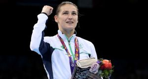 Katie Taylor celebrates  winning a  gold medal at the  2015 European Games in  Baku, Azerbaijan. Photograph: Ryan Byrne/Inpho