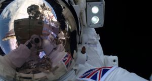 A  European Space Agency (ESA) image of astronaut Tim Peake taking part in his first  spacewalk to replace a failed power regulator and install cabling for the International Space Station. Photograph: ESA via Getty Images.