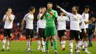 Manchester United's David De Gea celebrates at full time with Juan Mata, Matteo Darmian, Wayne Rooney and teammates. Photograph: Carl Recine/Reuters