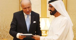 UAE vice president and prime minister, Sheikh Mohammed bin Rashid al-Maktoum with French foreign minister Laurent Fabius during their meeting at his palace in Dubai on Monday. Photograph: Karim Sahib/Getty Images
