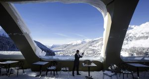 An employee of the InterContinental Hotel in Davos checks a bottle of champagne on the eve of the World Economic Forum. Photograph: Matthew Lloyd/Bloomberg
