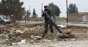 A Free Syrian Army fighter places a shell before firing it towards Islamic State fighters in the northern Aleppo countryside, Syria.  Aleppo's eastern quarters are held by insurgents while Isis has a presence in the countryside east and south of the city.   Photograph: Reuters