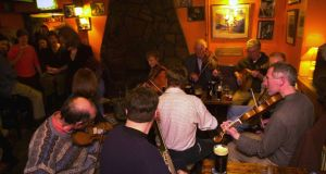 Visiting a pub is the number on reason people come to Ireland while listening to music in a pub is the number one reason they would return. File photograph: Frank Miller