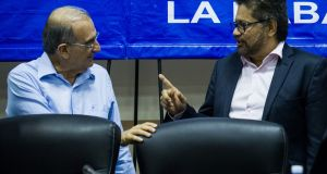 The head of the Farc delegation Ivan Marquez (R) and the head of the Colombian government delegation Humberto de la Calle (L) at peace talks  in Havana, Cuba. Photograph: Yamil Lage/AFP/Getty Images