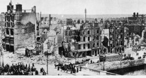 The bombed buildings at the corner of Sackville Street (now O'Connell Street) and Eden Quay on the banks of the Liffey in Dublin. The buildings were shelled by the British admiralty gunboat, the Helga, during the Easter Rising. Photograph: Getty Images
