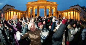 "People dance to the theme song of the ""One Billion Rising"" campaign in front of the Brandenburg Gate in Berlin February 14, 2013. One Billion Rising is a global coordinated campaign aimed to call for an end to violence against women and girls, according to its organisers. REUTERS/Fabrizio Bensch (GERMANY - Tags: SOCIETY)"