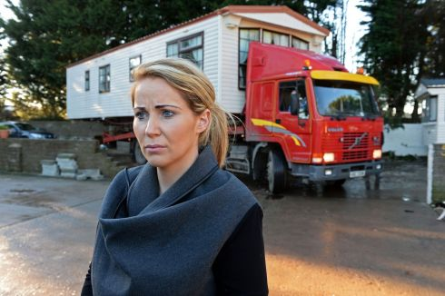 TRAVELLER EVICTIONS: Laura Quinn looks on as her mobile home is removed from a halting site at Woodland Park, Dundalk, Co Louth. Photograph: Eric Luke/The Irish Times