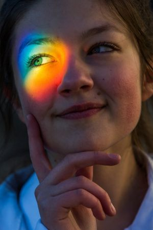 SCIFEST 2016: Light is refracted through a prism on to the face of Sefora Baes (14), a student at Fingal Community College in Dublin, at the launch of SciFest 2016. Photograph: Naoise Culhane